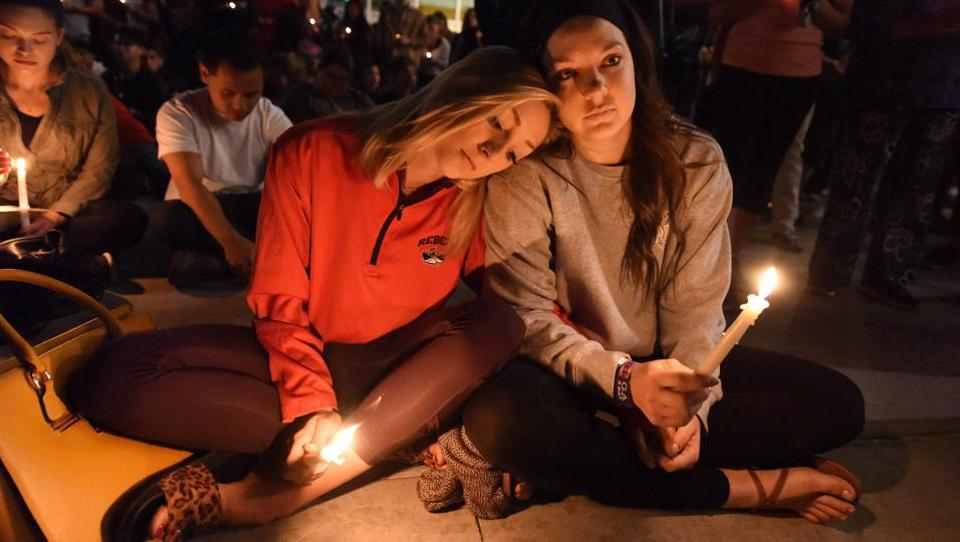 At the vigil were friends of the victims alongwith some survivors themselves. People attending the country music concert described scenes of horror as they realized that what they first thought were fireworks were actually gunshots. (Robyn Beck / AFP)