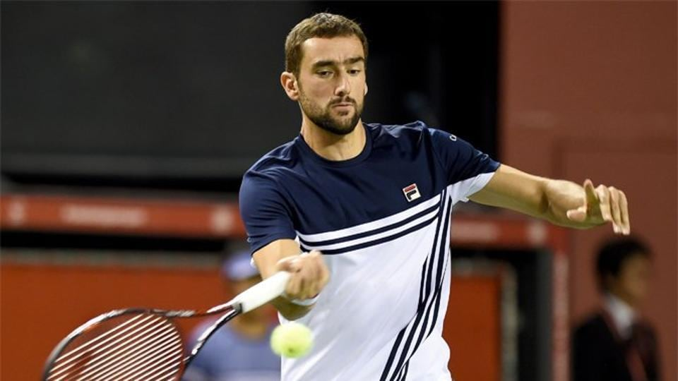 Marin Cilic beat local favourite Yasutaka Uchiyama 6-3, 6-4 to enter the Japan Open quarter-finals.