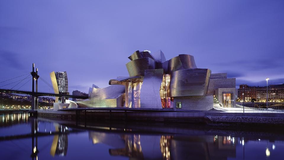 Initially, the Guggenheim Museum Bilbao was criticised for its glittering design, which some felt overwhelmed the art .