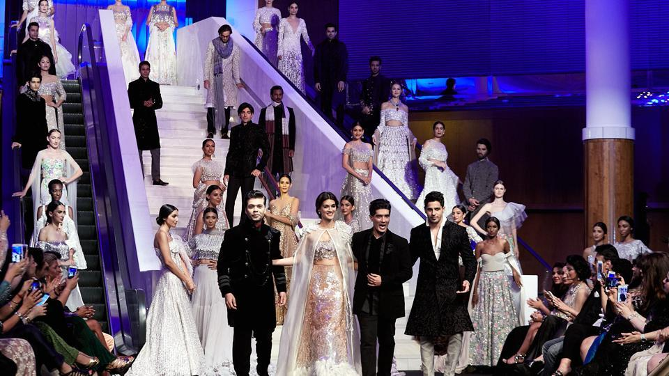 Actor Kriti Sanon, filmmaker Karan Johar and actor Sidharth Malhotra walked for Manish Malhotra  at Design One, Dubai