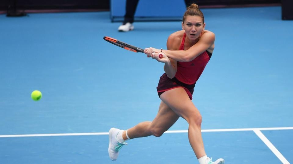 Simona Halep secured a first career win over Maria Sharapova to serve a warning to her rivals at the China Open.