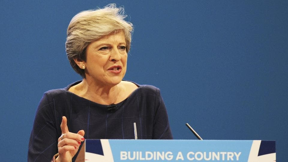 Conservative Party Leader and Prime Minister Theresa May addresses delegates during a speech at the Conservative Party Conference at Manchester Central in Manchester  Wednesday.