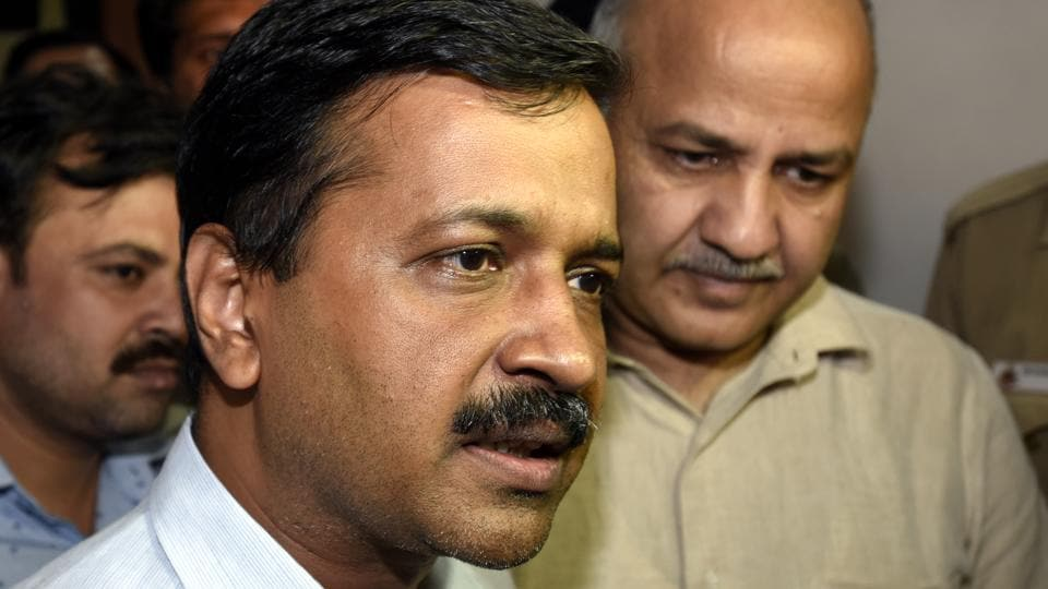 Delhi chief minister Arvind Kejriwal talks to media as deputy chief minister Manish Sisodia looks on at the Delhi Assembly on Wednesday.