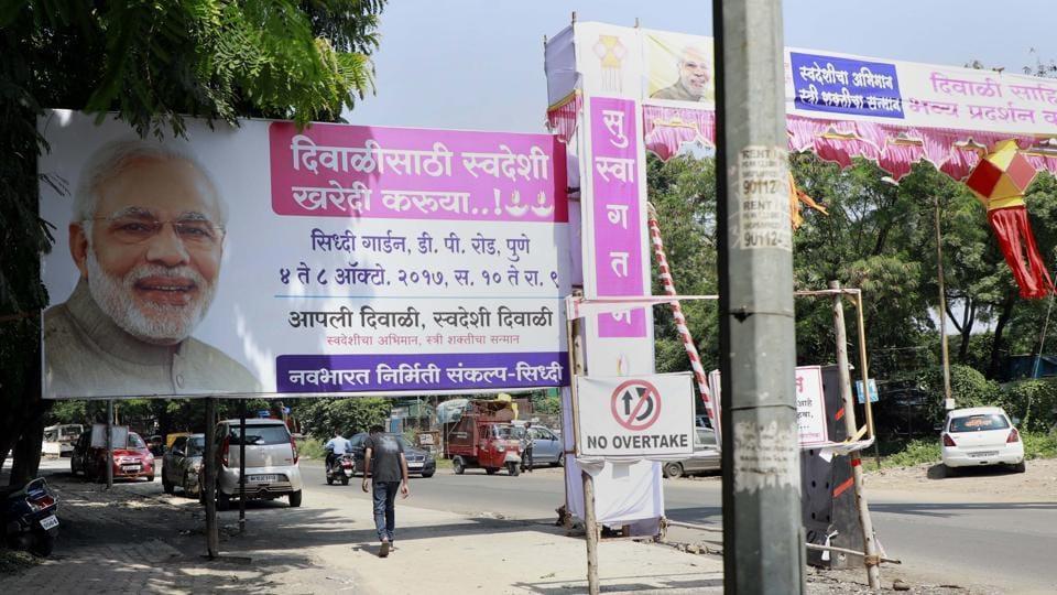 This hoarding blocks the entire footpath on DP road, Patwardhan Baug, Karvenagar.