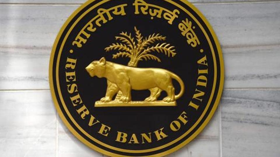 A plaque bearing the Reserve Bank of India logo hangs on the wall of the RBI headquarters in Mumbai on June 7.