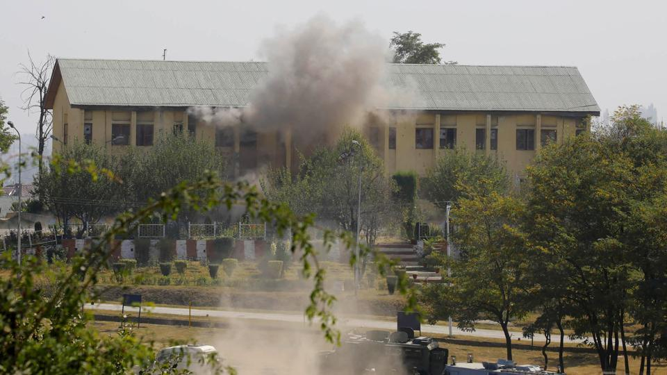 Smoke and dust rises from a Border Security Force (BSF) building, that was held by suspected militants, after it was hit by explosives fired by government forces in Srinagar on October 3, 2017.