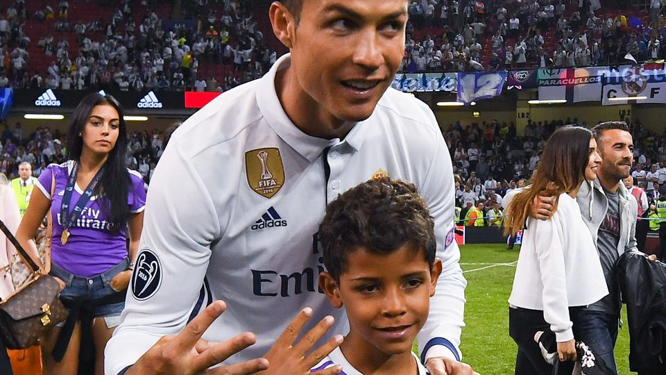 Cristiano Ronaldo of Real Madrid CF celebrates with his son Cristiano Ronaldo Jr. after the UEFA Champions League Final between Juventus and Real Madrid at National Stadium of Wales on June 3, 2017 in Cardiff.