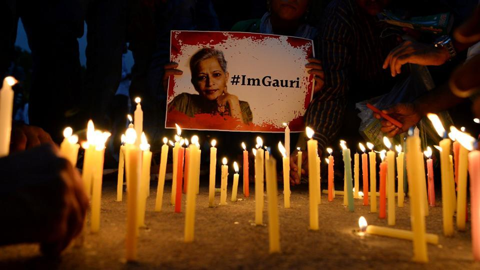 Activists take part in a protest rally against the killing of journalist Gauri Lankesh at the India Gate memorial in New Delhi on September 6, 2017.