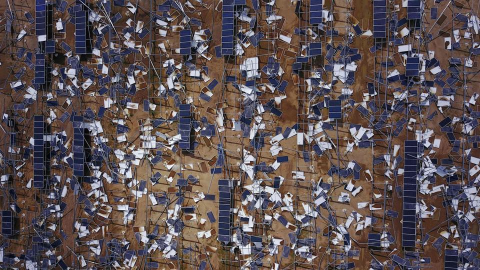 Solar panel debris is seen scattered in a solar panel field in the aftermath of Hurricane Maria in Humacao, Puerto Rico. (Ricardo  Arduengo / AFP)
