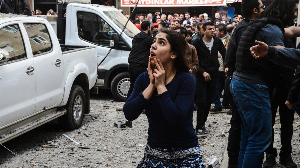 A woman reacts as she looks at the site of a strong blast that took place in Diyarbakir, Turkey, in April.