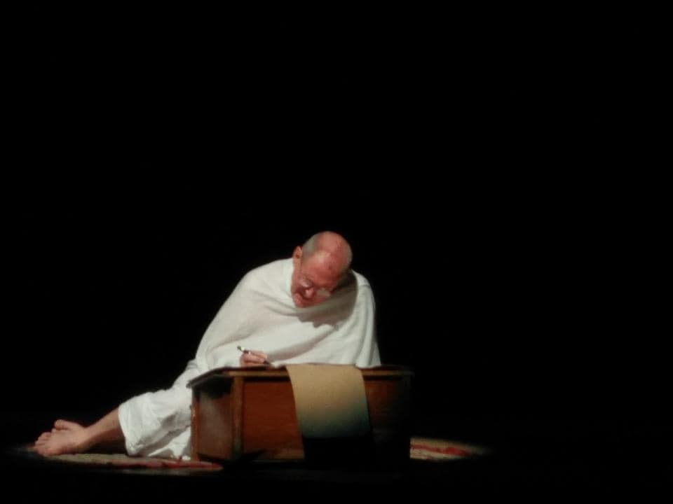 The late actor Tom Alter played the older Mahatma Gandhi in two shows of the play. Gandhi is shown working on his autobiography and adding notes from the Champaran movement to the book.