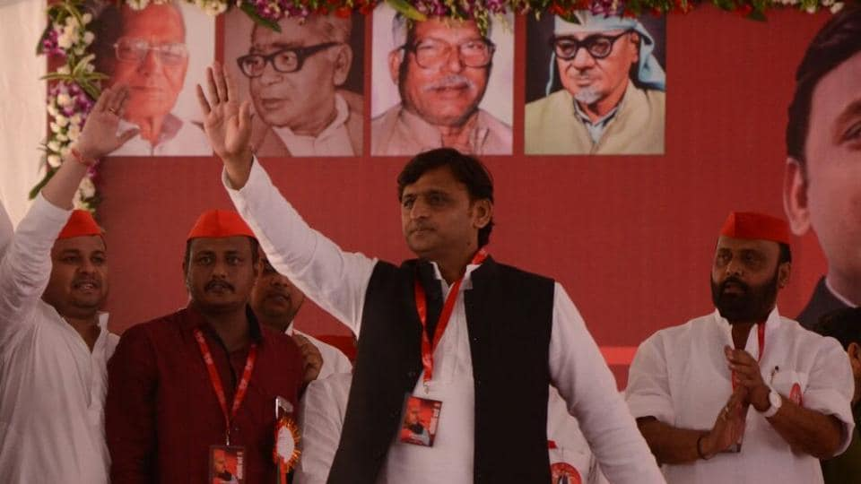 Akhilesh Yadav waves from the stage at the Samajwadi Party national convention in Agra on Thursday.