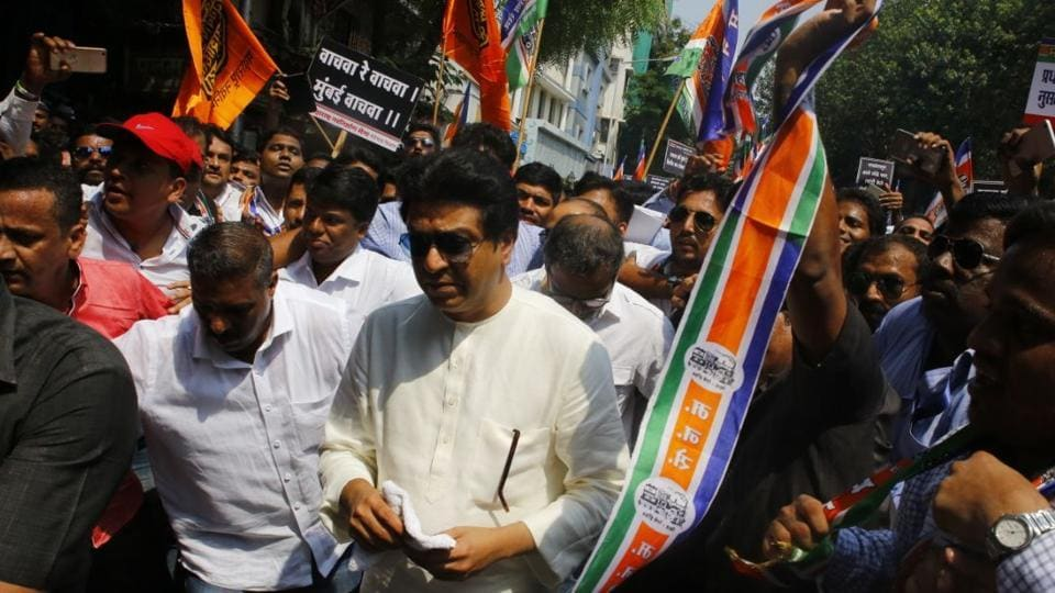 MNS chief Raj Thackeray walks along with supporters.