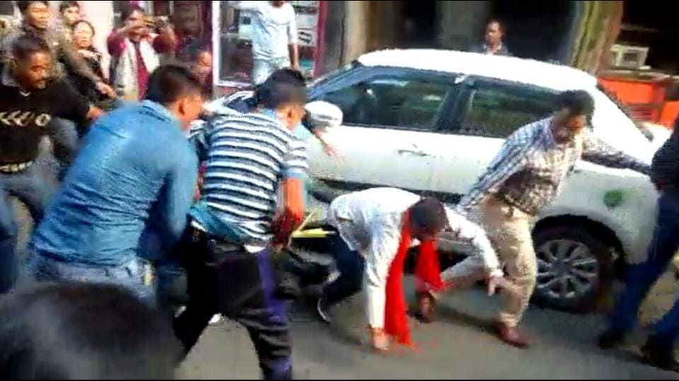 A BJP worker (wearing  saffron scarf) being assaulted by supporters of Benoy Tamang in Darjeeling on Thursday.