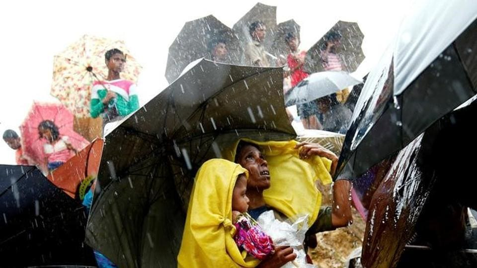 File photo of Rohingya refugees waiting for aid packages during rain in Cox's Bazar, Bangladesh, on September 17, 2017.