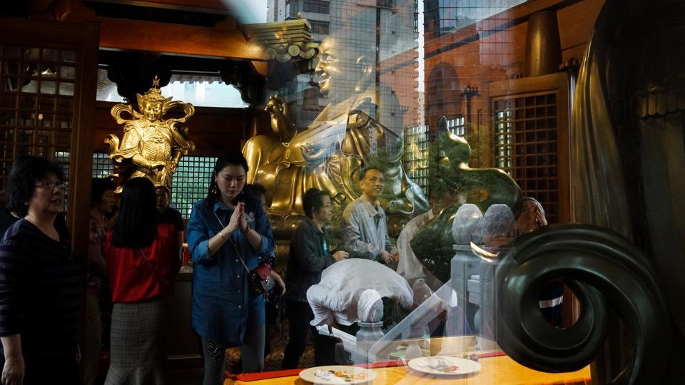 Chinese people pray at the Jing'an Temple in Shanghai. The Mid-Autumn festival is a popular East Asian celebration of abundance and togetherness, dating back to 3,000 years. (Chandan Khanna / AFP)
