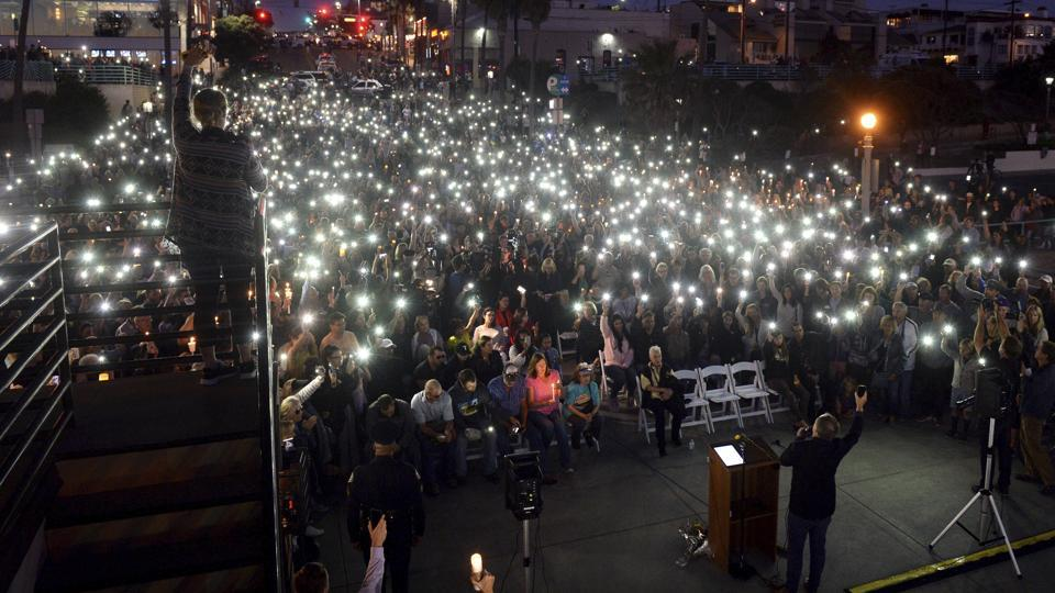 Cell phones and candles light the night during a vigil at the Manhattan Beach Pier, honouring victims in the Las Vegas mass shooting, in Manhattan Beach, California on October 4.