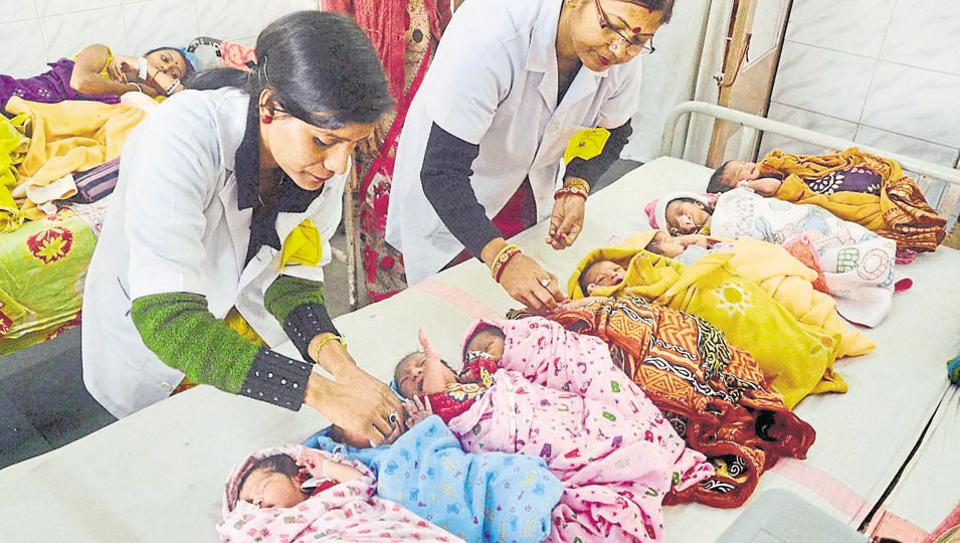 Health officials administer polio vaccine drops to newborn babies at a government hospital in Agartala.