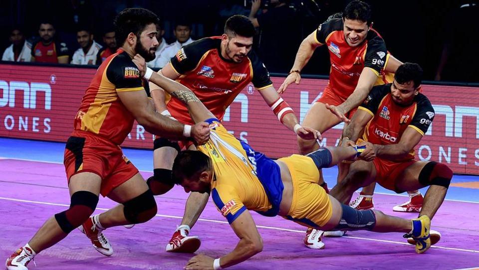 Tamil Thalaivas (yellow-blue jersey) and Bengaluru Bulls in action during the Pro Kabaddi League at the Jawaharlal Nehru Indoor Stadium in Chennai on Thursday.