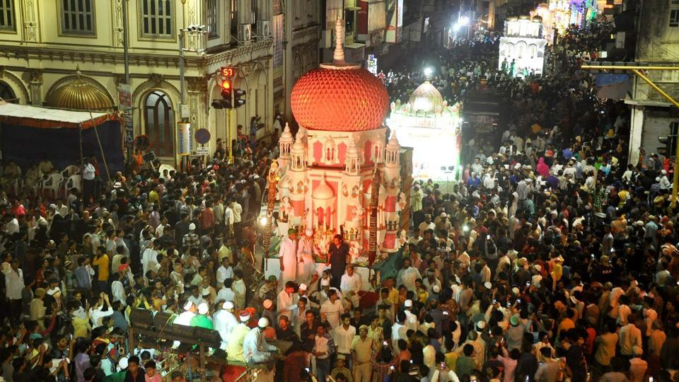 Muslims carrying Tazia, a replica of the mausoleum of Imam Hussain, during a Muharram procession in Surat.
