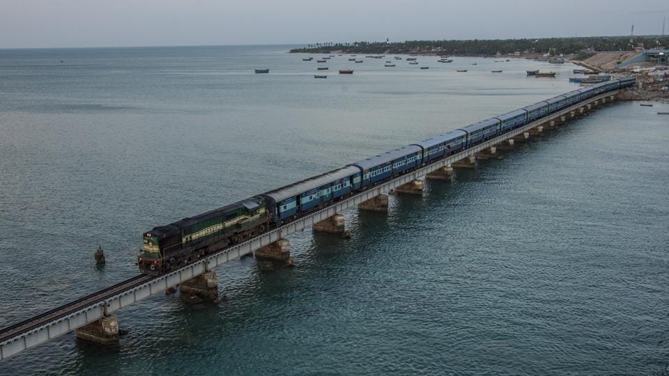 The Pamban Bridge connects Pamban Island and the port town of Rameswaram to mainland India. The island is a longstanding pilgrimage site due to mythological tales in which Lord Rama crossed a bridge called 'Rama Setu' to rescue his wife Sita from the demon king Ravana in modern Sri Lanka. (Atul Loke / NYT)