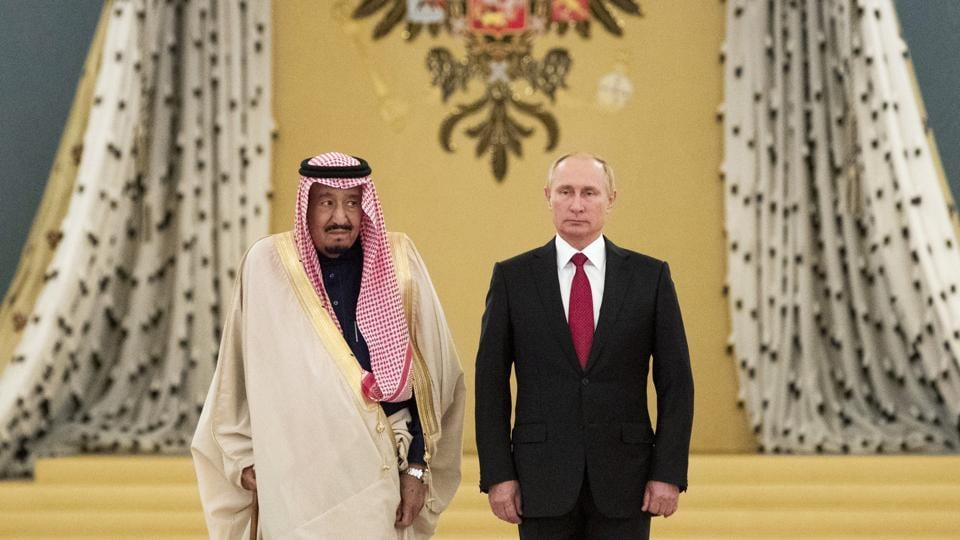 Russian President Vladimir Putin (right) and Saudi King Salman listen to national anthems during their meeting at the Kremlin in Moscow on October 5, 2017. The Saudi king arrived in Moscow on Wednesday on the first visit by a Saudi monarch to Russia.
