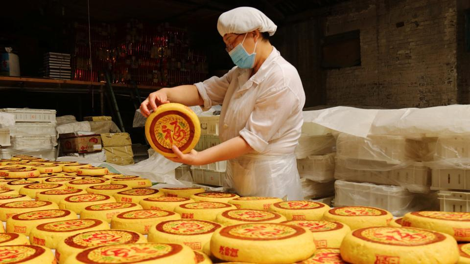 An employee checks freshly baked handmade moon-cakes at a traditional confectionary, ahead of the Mid-Autumn festival, in Zhangjiakou, Hebei province, China. Considered a delicacy, the cakes are offered to friends and at  family gatherings. (REUTERS)