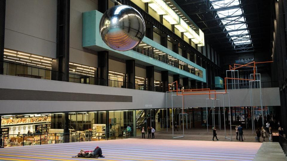 People lie beneath a pendulum at the Tate Modern in London. For the less active, visitors can lie on a carpet and be hypnotized by a large mirrored ball swinging from the ceiling. (Jack Taylor / Getty Images)