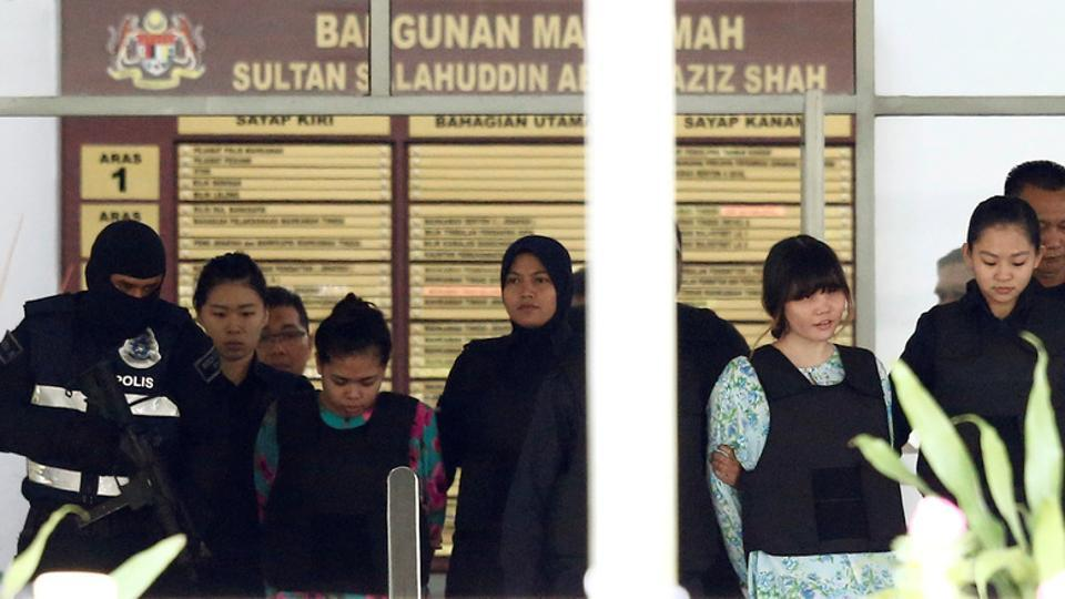 Vietnamese Doan Thi Huong and Indonesian Siti Aisyah who are on trial for the killing of Kim Jong Nam, the estranged half-brother of North Korea's leader, are escorted as they leave the Shah Alam High Court on the outskirts of Kuala Lumpur, Malaysia on October 3.