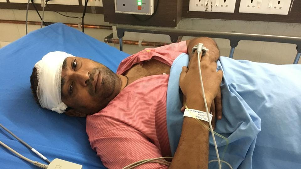 Teacher Dhananjay Abnave in hospital after the attack.