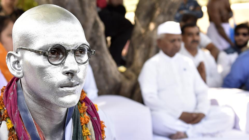 A supporter of Anna Hazare impersonates the 'Father of the Nation' Mahatma Gandhi during Hazare's day-long hunger strike for implementation of the Lokpal Bill on the birth anniversary of Mahatma Gandhi on Monday. (Ajay Aggarwal / HT Photo)