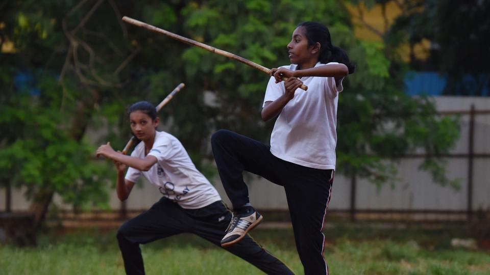 Anushka Mane (Right) and Sakshi Patil display their skill in single stick, a type of Silambam, a weapon-based Indian Martial arts form in Pune on Wednesday. (Pratham Gokhale/HT Photo)