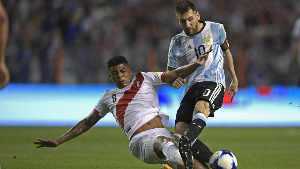 Argentina national football team's Lionel Messi (R) gets tackled by Peru national football team's Wilder Cartagena during their FIFAWorld Cup 2018 qualifier match in Buenos Aires on Thursday.