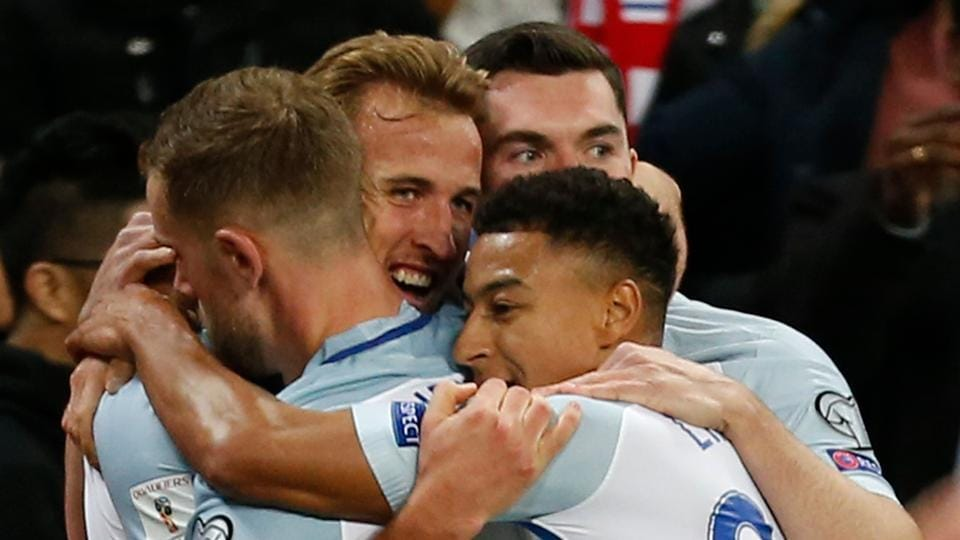England national football team striker Harry Kane (2L) celebrates with teammates after scoring the sinnger against Slovenia national football team during their FIFA World Cup 2018 qualification match at Wembley Stadium in London on Thursday.