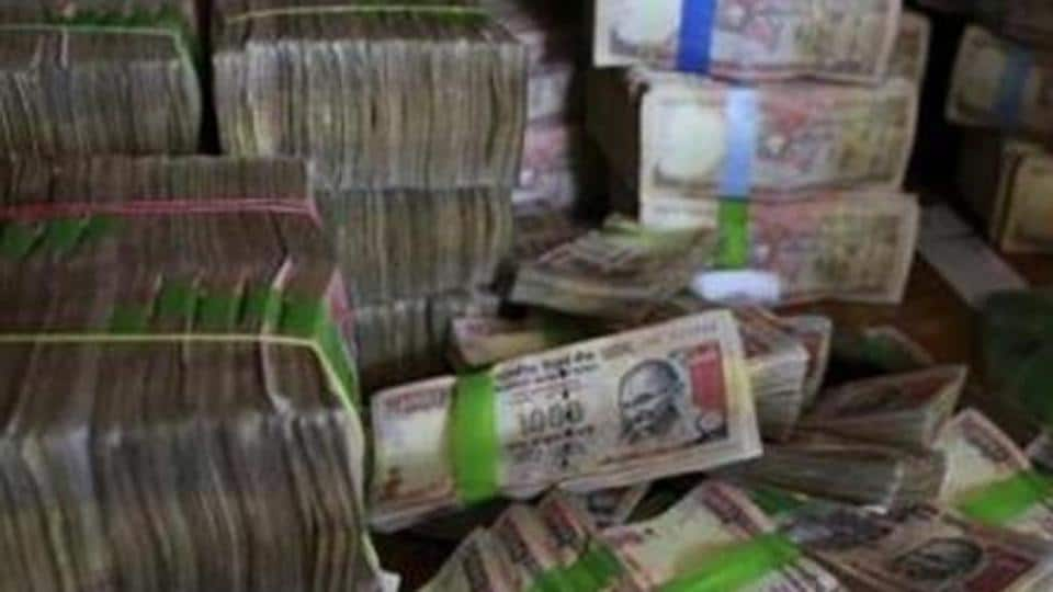 Discontinued Indian currency notes of 1,000 denomination seen after they were deposited at a bank in Bangalore, India.