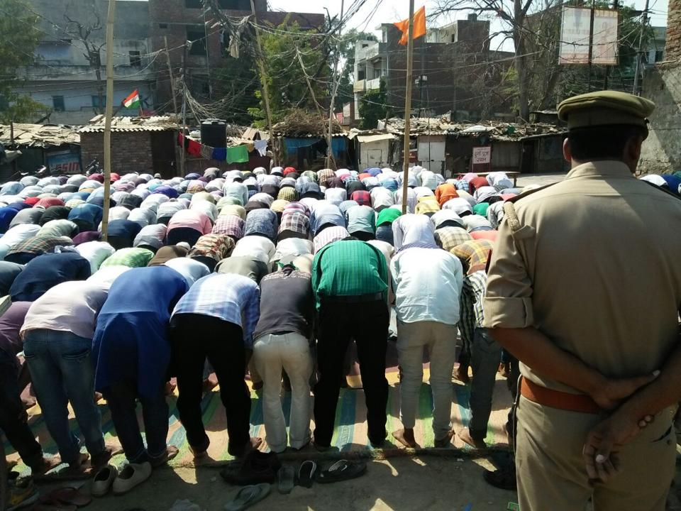 Muslims offer prayers amid tight security at Chatai Wali mosque in Noida's Sector 9 on Friday