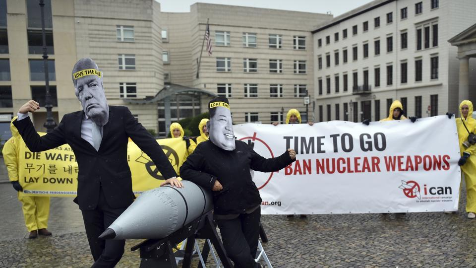 Activists of the International Campaign to Abolish Nuclear Weapons (ICAN) protest against the conflict between North Korea and the USA with masks of Kim Jong Un and Donald Trump in front of the US embassy in Berlin, Germany.
