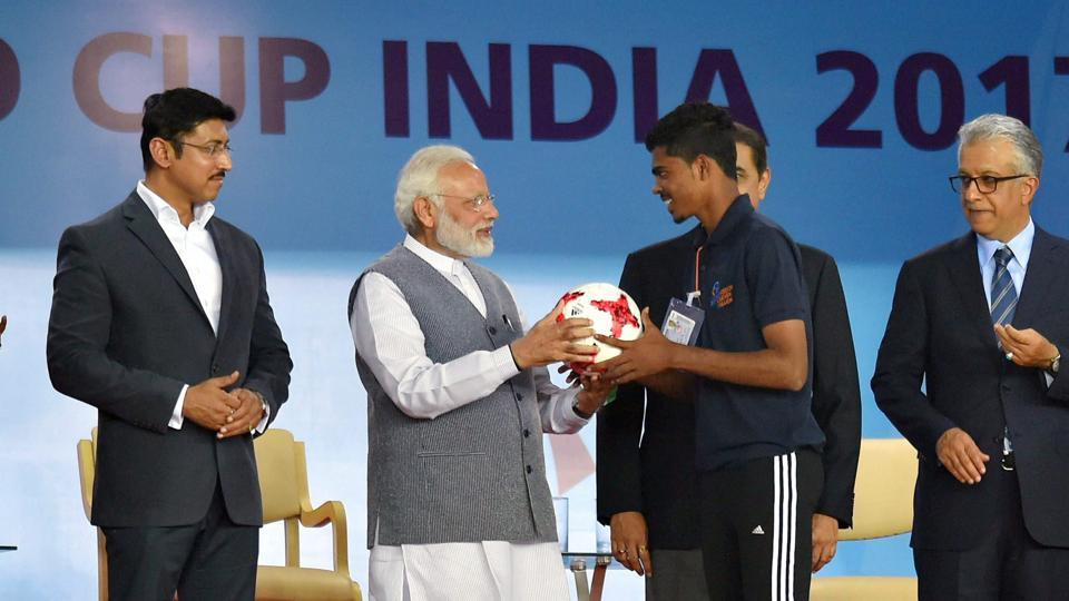 Prime Minister Narendra Modi felicitated some football players before the start of the FIFA U-17 World Cup match between Indian Under-17 football team and USA Under-17 side at the Jawaharlal Nehru Stadium in New Delhi.
