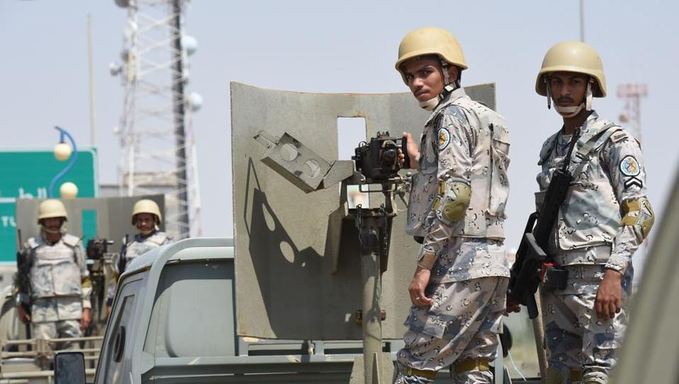 Saudi border guards stand guard in the closed al-Tuwal border crossing with Yemen in the southern Jizan province on October 3, 2017.