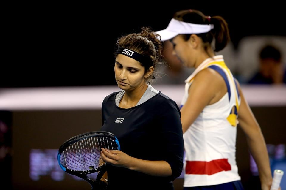 Sania Mirza and partner Peng Shuai of China react during their Women's double quarterfinal match against Katerina Siniakova of Czech Republic and Barbora Strycova of Czech Republic on Friday. The beat the Czech pair to enter the semis where they lost to Martina Hingis and Chan Yung-jan.