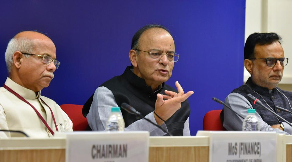Union finance minister Arun Jaitley (centre) with MoS for finance Shiv Pratap Shukla (right) and revenue secretary Hasmukh Adhia (left) address the media after the 22nd meeting of the GST Council, in New Delhi on Friday.