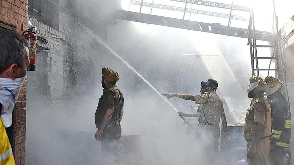 Firemen trying to douse flames at the Devdarshan Dhoop factory in the Industrial Area, Phase 2, Chandigarh on Friday.