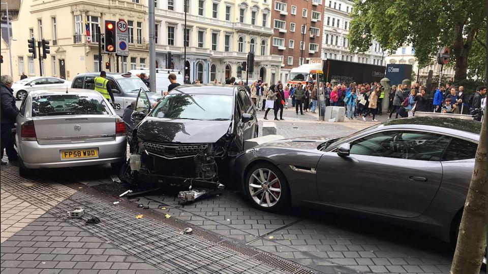 A handout picture obtained from the twitter user @StefanoSutter shows damaged vehicles on Exhibition Road, in between the Victoria and Albert (V&A) museum, and the Natural History Museum, in London on Saturday.