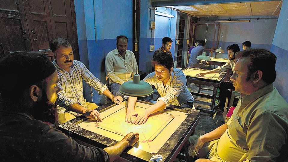 Arshad Mirza's (right) Mirza Club is located in a living room on the ground floor of a haveli, famous as the Bada Makan, in the Pahadi Bhojla area, near Jama Masjid.