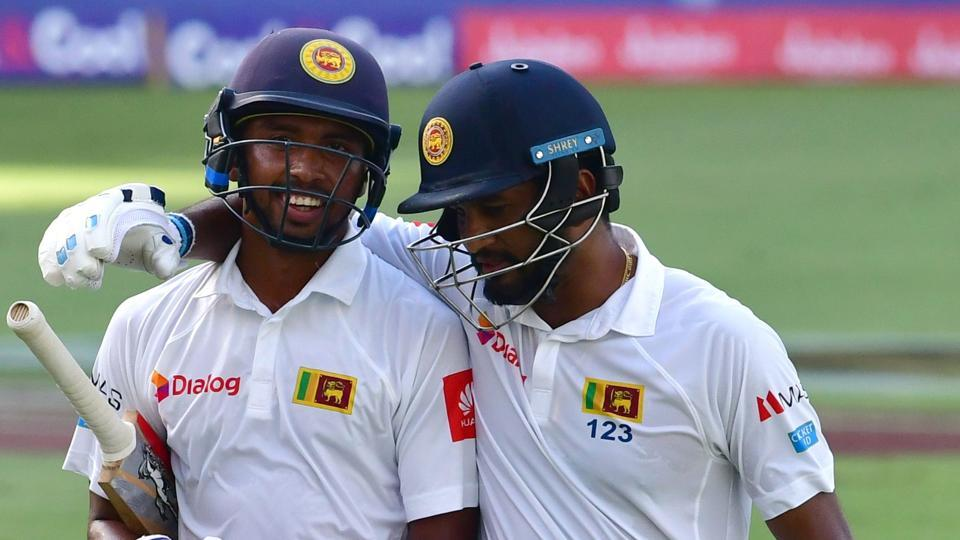 Sadeera Samarawickrama (L) and Dimuth Karunarathna of Sri Lanka cricket team leave the field after the first day of the second Test vs Pakistan cricket team (Pink ball Test) at Dubai International Stadium on Friday.