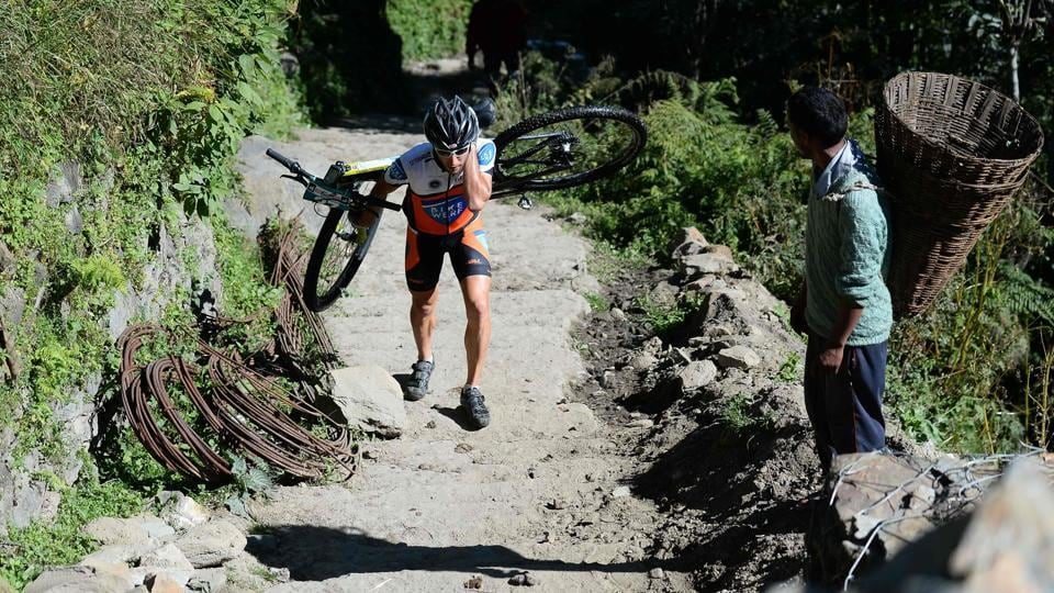Jochen Boehringer of Germany competes in the 13th edition of the Hero MTB Himalaya mountain bike race in Kangra district, Himachal Pradesh. The annual race took place in the foothills of the Himalayas, starting in Shimla and ending in Dharamshala. (AFP / SAJJAD HUSSAIN)