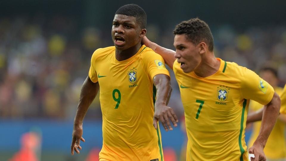Lincoln (L) of Brazil runs along with his teammate to celebrate a goal against Spain during their Group D stage football match in the FIFA U-17 World Cup played at the Jawaharlal Nehru International Stadium in Kochi on October 7, 2017. Brazil won 2-1 to go atop of Group D.