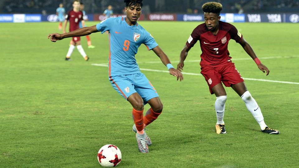 Aniket Jadhav of India and Cris Gloster of USA in action during the FIFA U- 17 World Cup match at Jawaharlal Nehru Stadium in New Delhi, India, on Friday. (Mohd Zakir/HT PHOTO)