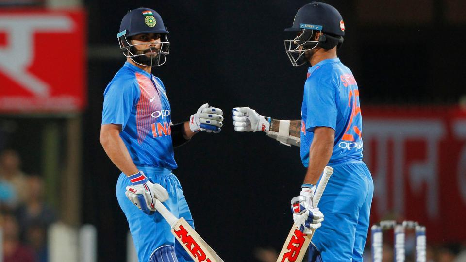 Virat Kohli and Shikhar Dhawan guided India to a nine-wicket win via DLS method as Australia suffered their seventh consecutive loss in T20Is against Virat Kohli's side. Catch full cricket score of India vs Australia, 1st T20I from Ranchi here.