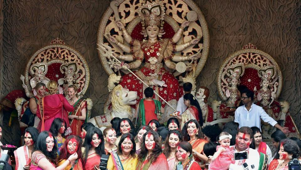 Trinamool Congress MP & film actress Moon Moon Sen is seen with other film actresses taking part in 'Sindur Khela' in front of a Goddess Durga idol at a puja pandal in Kolkata. (Ashok Bhaumik / PTI)